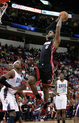 Oct 23, 2012; Raleigh, NC, USA;  Miami Heat small forward LeBron James (6) drives in for the dunk against Charlotte Bobcats center Brendan Haywood (33) in the first half at PNC Arena. Mandatory Credit: Mark Dolejs-US PRESSWIRE