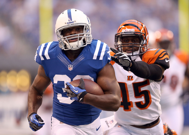 INDIANAPOLIS, IN - AUGUST 30:  Vick Ballard #33 of the Indianapolis Colts runs with the ball while defended by Jeromy Miles #45 of the Cincinnati Bengals at Lucas Oil Stadium on August 30, 2012 in Indianapolis, Indiana.  (Photo by Andy Lyons/Getty Images)