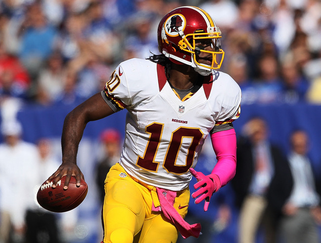 EAST RUTHERFORD, NJ - OCTOBER 21:  Quarterback Robert Griffin III #10 of the Washington Redskins drops back to pass against the New York Giants at MetLife Stadium on October 21, 2012 in East Rutherford, New Jersey.  (Photo by Alex Trautwig/Getty Images)