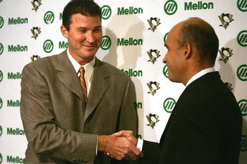 NHL Great Mario Lemieux Shakes Hands With NHL Exile Jim Balsillie