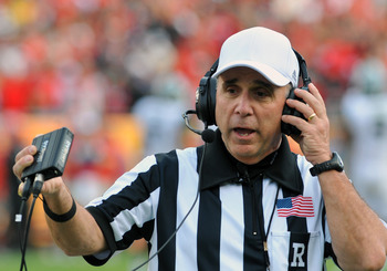 TAMPA, FL - JANUARY 02: NCAA referee Ed Ardito reviews a play as the Georgia Bulldogs battle the Michigan State Spartans in the Outback Bowl January 2, 2012 at Raymond James Stadium in Tampa, Florida. (Photo by Al Messerschmidt/Getty Images)