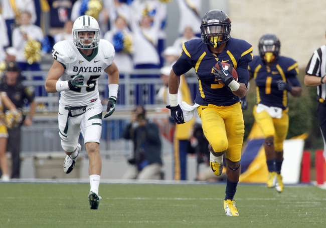 MORGANTOWN, WV - SEPTEMBER 29:  Stedman Bailey #3 of the West Virginia Mountaineers catches an eighty seven yard touchdown pass against the Baylor Bears during the game on September 29, 2012 at Mountaineer Field in Morgantown, West Virginia.  WVU defeated