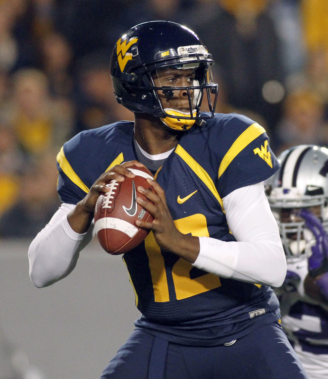 MORGANTOWN, WV - OCTOBER 20:  Geno Smith #12 of the West Virginia Mountaineers drops back to pass against the Kansas State Wildcats during the game on October 20, 2012 at Mountaineer Field in Morgantown, West Virginia.  (Photo by Justin K. Aller/Getty Ima