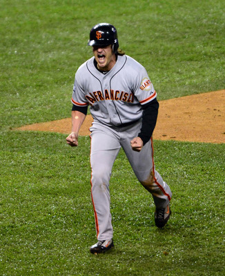 Theriot explodes in elation after scoring the go-ahead run in Game 4.