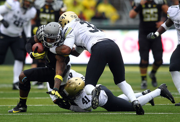 Oregon improved to 8-0, destroying Colorado 70-14 last week.