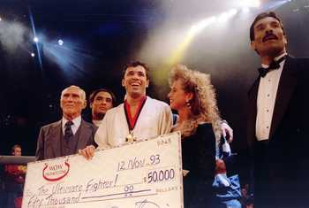 Jiu-Jitsu black belt Royce Gracie (USA) receives a $50,000 check after becoming 'The Ultimate Fighter' by defeating Gerard Gordeau of the Netherlands int he finals of the Ultimate Fighter Championships in Denver, Colorado.  Mandatory Credit: Markus Boesch