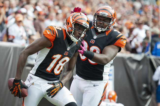 CLEVELAND, OH - OCTOBER 14: A.J. Green #18 celebrates with fullback Chris Pressley #36 of the Cincinnati Bengals during the second quarter after Green scored a touchdown against the Cleveland Browns at Cleveland Browns Stadium on October 14, 2012 in Cleve