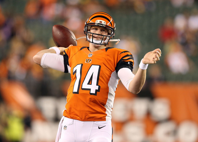 CINCINNATI, OH - OCTOBER 21:  Andy Dalton #14 of the Cincinnati Bengals throws a pass before the NFL game against the Pittsburgh Steelers at Paul Brown Stadium on October 21, 2012 in Cincinnati, Ohio.  (Photo by Andy Lyons/Getty Images)