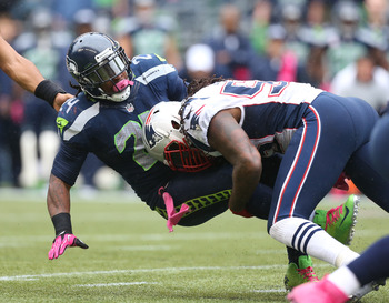 SEATTLE, WA - OCTOBER 14: Running back Marshawn Lynch #24 of the Seattle Seahawks is tackled by middle linebacker Brandon Spikes #55 of the New England Patriots at CenturyLink Field on October 14, 2012 in Seattle, Washington. (Photo by Otto Greule Jr/Gett