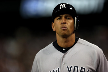 DETROIT, MI - OCTOBER 18:  Alex Rodriguez #13 of the New York Yankees walsk off the field back to the dugout after he grounded out in the top of the 9th inning against the Detroit Tigers during game four of the American League Championship Series at Comer
