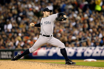 DETROIT, MI - OCTOBER 18:  David Robertson #30 of the New York Yankees throws a pitch against the Detroit Tigers during game four of the American League Championship Series at Comerica Park on October 18, 2012 in Detroit, Michigan.  (Photo by Leon Halip/G