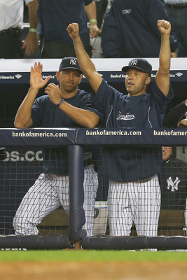 NEW YORK, NY - OCTOBER 03:  Derek Jeter #2 and Alex Rodriguez #13 of the New York Yankees celebrate the win over the Boston Red Sox on October 3, 2012 at Yankee Stadium in the Bronx borough of New York City. With the win, the New York Yankees clinch the A