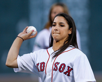 BOSTON, MA - AUGUST 25:  Aly Raisman, winner of the gold medal in gymnastics at the 2012 Summer Olynpics, throws out a ceremonial pitch before a game between the Kansas City Royals and the Boston Red Sox at Fenway Park on August 25, 2012 in Boston, Massac