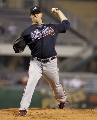 The Braves picked up their 2013 option on Paul Maholm.