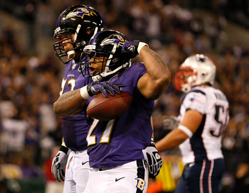 Ray Rice celebrates after scoring against New England