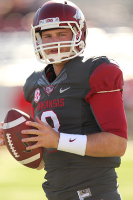 Oct 27, 2012; Little Rock, AR, USA; Arkansas Razorbacks quarterback Tyler Wilson (8) warms up prior to the game against the Ole Miss Rebels at War Memorial Stadium. Mandatory Credit: Nelson Chenault-US PRESSWIRE