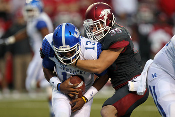 Oct 13, 2012; Fayetteville, AR, USA; Arkansas Razorbacks safety Ross Rasner (35) sacks Kentucky Wildcats quarterback Jalen Whitlow (13) at Donald W. Reynolds Razorback Stadium. Mandatory Credit: Nelson Chenault-US PRESSWIRE