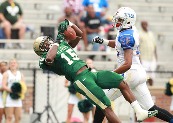Sept 29, 2012; Birmingham, AL, USA;  UAB Blazers wide receiver Jackie Williams (15) catches a pass as Tulsa Golden Hurricanes defensive back Dexter McCoil (26) defends at Legion Field.   Mandatory Credit: Marvin Gentry-US PRESSWIRE