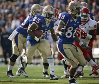 TULSA, OK - NOVEMBER 25:  Running back Ja'Terian Douglas #25 of the Tulsa Hurricanes looks for a hole in the first half against the Houston Cougars on November 25, 2011 at H.A. Chapman Stadium in Tulsa, Oklahoma.  Houston defeated Tulsa 48-16.  (Photo by