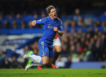 LONDON, ENGLAND - OCTOBER 28:  Fernando Torres of Chelsea goes to ground leading to his sending off during the Barclays Premier League match between Chelsea and Manchester United at Stamford Bridge on October 28, 2012 in London, England.  (Photo by Michae