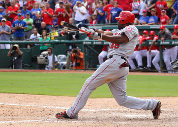 Outfielder Torii Hunter swinging at a pitch against the Texas Rangers.
