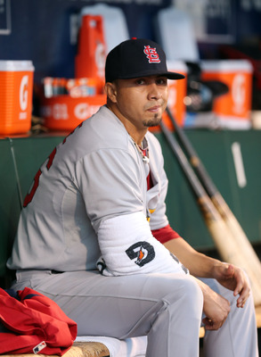 Kyle Lohse sits in the dugout in a postseason game against the San Francisco Giants.