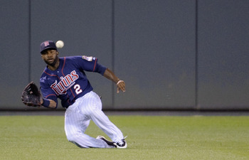 MINNEAPOLIS, MN - JULY 30: Denard Span #2 of the Minnesota Twins makes a catch in center field against the Chicago White Sox during the seventh inning on July 30, 2012 at Target Field in Minneapolis, Minnesota. The Twins defeated the White Sox 7-6. (Photo
