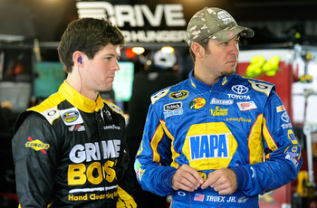 RIDGEWAY, VA - OCTOBER 26:  Martin Truex Jr. (R), driver of the #56 NAPA Auto Parts Toyota, stands beside brother Ryan Truex, driver of the #27 The Classic at The Rock Chevrolet, in the garage area during practice for the NASCAR Sprint Cup Series Tums Fas