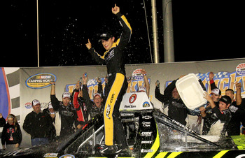 SPARTA, KY - SEPTEMBER 21:  James Buescher, driver of the #31 Wolfpack Rentals Chevrolet, celebrates after winning the NASCAR Camping World Truck Series Kentucky 201 at Kentucky Speedway on September 21, 2012 in Sparta, Kentucky. (Photo by Sean Gardner/Ge