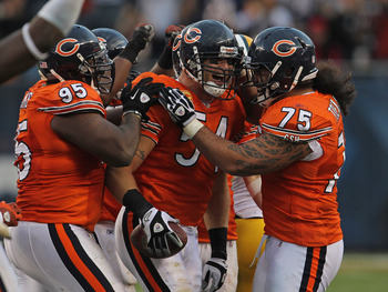 Bears defense celebrates an Urlacher interception