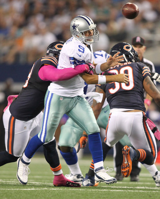 Henry Melton gets a QB hit on Tony Romo