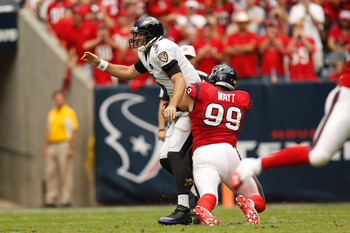 Joe Flacco avoids the sack by J.J. Watt