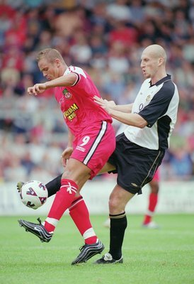 Stam (right) was as imposing a centre back as the Premier League has seen