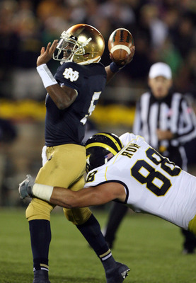 Michigan DE Craig Roh (88) and Notre Dame QB Everett Golson (5)