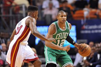 Oct 30, 2012; Miami, FL, USA; Boston Celtics shooting guard Leandro Barbosa (12) dribbles past Miami Heat point guard Norris Cole (30) during the first half at American Airlines Arena. Mandatory Credit: Steve Mitchell-US PRESSWIRE