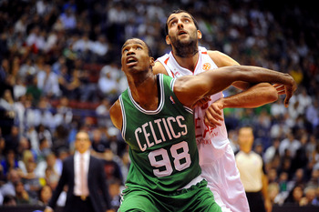 MILAN, ITALY - OCTOBER 07:  Jason Collins # 98 of Celtics competes with Ioannis Bourousis # 15 of Armani during the NBA Europe Live game between EA7 Emporio Armani Milano v Boston Celtics at Mediolanum Forum  on October 7, 2012 in Milan, Italy.  (Photo by