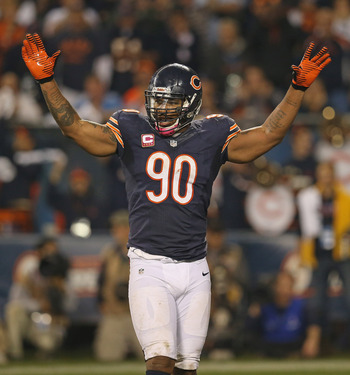 CHICAGO, IL - OCTOBER 22:  Julius Peppers #90 of the Chicago Bears encourages the crowd against the Detroit Lions at Soldier Field on October 22, 2012 in Chicago, Illinois. The Bears defeated the Lions 13-7.  (Photo by Jonathan Daniel/Getty Images)