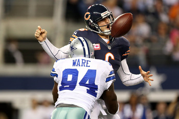 ARLINGTON, TX - OCTOBER 01:  Jay Cutler #6 of the Chicago Bears fumbles the ball as he is sacked by DeMarcus Ware #94 of the Dallas Cowboys in the third quarter at Cowboys Stadium on October 1, 2012 in Arlington, Texas.  (Photo by Ronald Martinez/Getty Im
