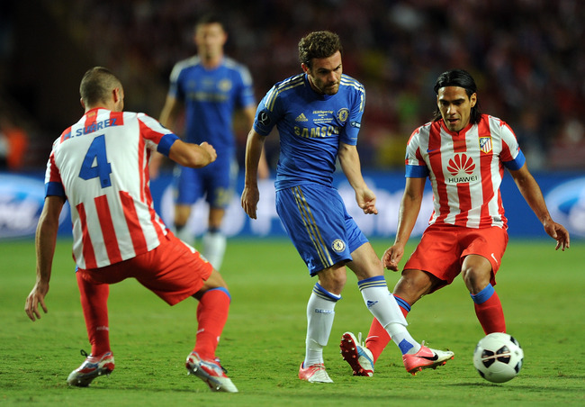 MONACO - AUGUST 31:  Juan Mata of Chelsea in action with Mario Suarez (L) and Falcao of Atletico Madrid during the UEFA Super Cup match between Chelsea and Atletico Madrid at Louis II Stadium on August 31, 2012 in Monaco, Monaco.  (Photo by Chris Brunskil