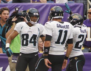 MINNEAPOLIS, MN - SEPTEMBER 9: Cecil Shorts #84 of the Jacksonville Jaguars celebrates with teammates Blaine Gabbert #11 and Montell Owens #24 after scoring a touchdown late in the fourth quarter against the Minnesota Vikings during NFL opening day Septem