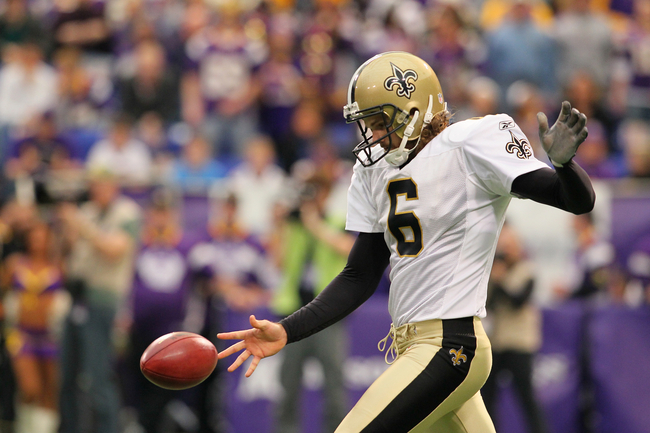 MINNEAPOLIS, MN - DECEMBER 18:    Thomas Morstead #6 of the New Orleans Saints kicks the ball against the Minnesota Vikings at the Hubert H. Humphrey Metrodome on December 18, 2011 in Minneapolis, Minnesota.  (Photo by Adam Bettcher /Getty Images)