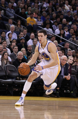 OAKLAND, CA - FEBRUARY 15:  Klay Thompson #11 of the Golden State Warriors in action against the Portland Trail Blazers at Oracle Arena on February 15, 2012 in Oakland, California. NOTE TO USER: User expressly acknowledges and agrees that, by downloading