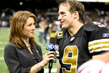 November 6, 2011; New Orleans, LA, USA; Fox sideline reporter Jennifer Hale (left) interviews New Orleans Saints quarterback Drew Brees (9) following a win over the Tampa Bay Buccaneers at the Mercedes-Benz Superdome. The Saints defeated the Buccaneers 27