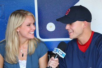 KANSAS CITY, MO - AUGUST 05: NESN reporter Heidi Watney interviews Justin Masterson #63 of the Boston Red Sox prior to action against the Kansas City Royals on August 5, 2008 at Kauffman Stadium in Kansas City, Missouri. (Photo by G. Newman Lowrance/Getty