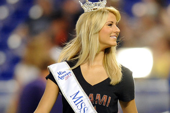 July 29, 2012; Miami, FL, USA; Miss Florida 2012 winner Laura Mckeeman throws out the first pitch before a game between the San Diego Padres and the Miami Marlins at Marlins Park. Marlins won in 10 inning 5-4. Mandatory Credit: Steve Mitchell-US PRESSWIRE