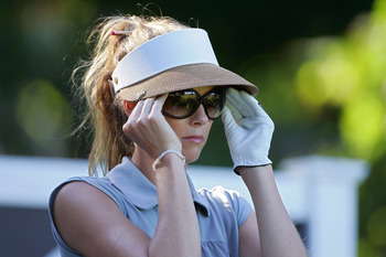 GALLOWAY, NJ - JUNE 18:  Anna Rawson of Australia adjusts her sunglasses during the first round of the ShopRite LPGA Classic held at Dolce Seaview Resort (Bay Course) on June 18, 2010 in Galloway, New Jersey.  (Photo by Michael Cohen/Getty Images)