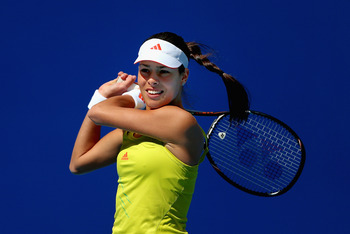 BEIJING, CHINA - OCTOBER 03:  Ana Ivanovic of Serbia returns a shot to Romina Oprandi of Switzerland during the Day 5 of China Open at the China National Tennis Center on October 3, 2012 in Beijing, China.  (Photo by Feng Li/Getty Images)