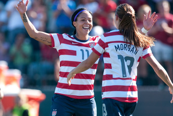 September 1, 2012; Rochester, NY, USA; USA forward Sydney Leroux (11) celebrates her goal with teammate Alex Morgan (13) during a friendly match against Costa Rica at Sahlen's Stadium. United States won the match 8-0. Mandatory Credit: Mark Konezny-US PRE
