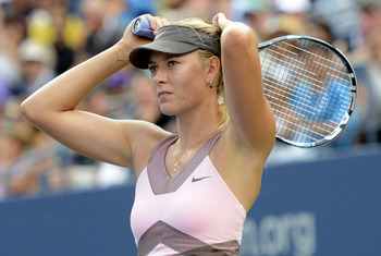 Sep 7, 2012; Queens, NY, USA; Maria Sharapova (RUS) reacts after losing a point in her match against Victoria Azarenka (BLR) on day twelve of the 2012 US Open at Billie Jean King National Tennis Center. Azarenka won 3-6, 6-2, 6-4. Mandatory Credit: Jerry