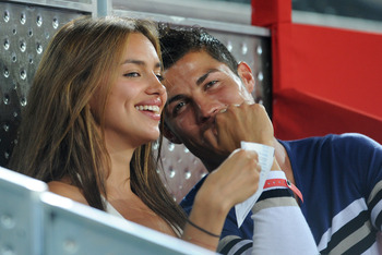 MADRID, SPAIN - AUGUST 22:  Cristiano Ronaldo (R) of Real Madrid watches a friendly basketball between Spain and the USA with Irina Shayk at La Caja Magica on August 22, 2010 in Madrid, Spain.  (Photo by Jasper Juinen/Getty Images)